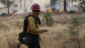 Firefighter using a Sling Psychrometer.
