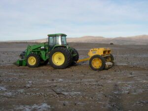 Rangeland Drill pulled by rear-wheel-drive tractor