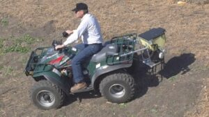 Seed Slinger Attachment on ATV